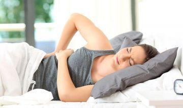 dolor de espalda en la cama